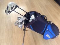 GOLF CLUBS AS NEW FULL SET OF LIGHT WEIGHT CAVITY BACK IRONS WITH STEEL SHAFTS. & BAG .