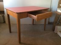 Desk. Light oak Red Formica type top legs are bolted on to be removed for transport