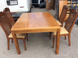 Very nice extendable dining room table and four chairs $135.00