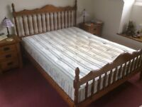 King size pine bed frame with mattress.