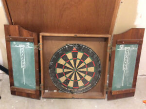 Dart board and cabinet