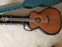 Solid Hardwood acoustic guitar with case.