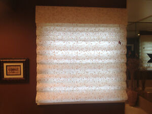 Beige coloured patterned roman shade