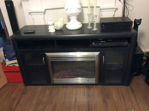 Black entertainment centre with electric fireplace