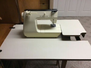 New price Singer Touch Tronic Sewing machine+cabinet $150.00