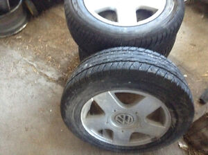 4 Volkswagen Jetta aluminum rims with Dunlop tires