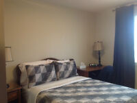 Room with double or  twin bed, opening windows