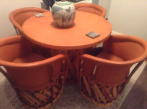 Hand made Mexican dining table with four chairs. Brand new.