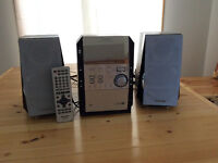Panasonic Stereo Stsyem with 5 cd changer, two speakers & remote