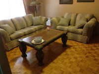 Sofa and love seat with large wood coffee table