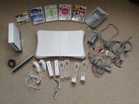 Nintendo Wii bundle- console, balance board, 2 controllers, 5 games