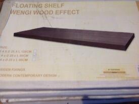 Three floating wood effect shelves