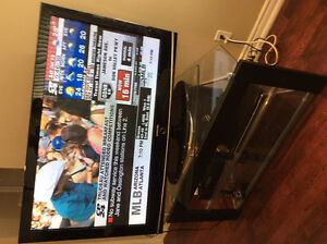 Samsung TV with  Glass top revolving stand