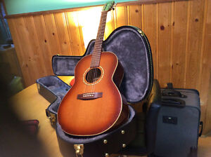 Simon and Patrick acoustic guitar with new hard shell case