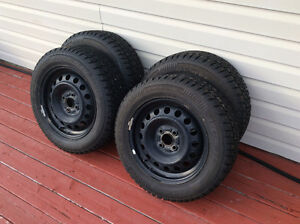 4 studded Artic Claw Winter Tires on Rims