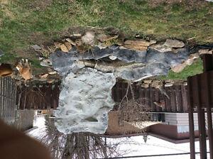 Mountain fountain with pond