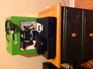 Xbox one with 80 games and headset and battery's 1 controller