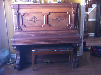 Piano and bench for sale.