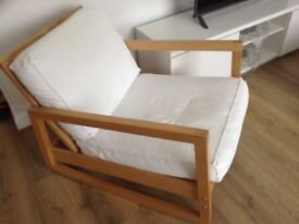 Swinging arm chair