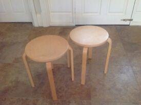 2 light wood stools