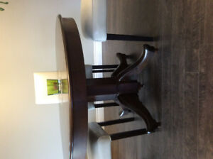 solid dark wood round dining table $100 or BO
