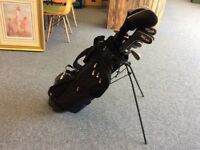 10 Texan Classics Golf Clubs in a black and blue carrier with a built in stand.
