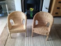 2 children's wicker chairs and table