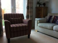 Armchair in beautiful stripy fabric. As new condition.