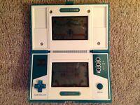 Three rare Nintendo Game & Watch retro handheld games.