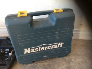 Electric mastercraft drill and tool box and some tools in box.