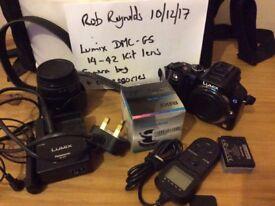 Lumix DMC-G5 Mirrorless camera with accessories.