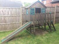 Children's outdoor wooden playhouse with slide