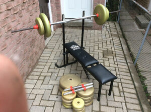 Bench with 100lbs, bar and 2 dumbell set ups