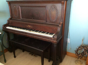 Beautiful old piano and bench for sale