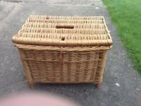 A WHICKER FISHING BASKET