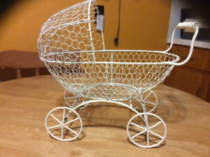 Cream coloured chicken wire carriage