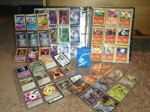 Binder of Pokemon Cards (a variety of 625+ cards) and Holder