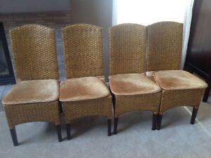 4 Pier 1 dining chairs and Pier 1 chair pads