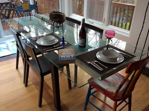 Elegant glass, chrome, and dark wood dining table with 6 chairs.