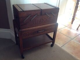 Vintage dark oak sewing box on casters. Very attractive.