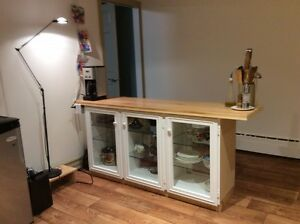 Kitchen cabinet with glass doors and glass shelves