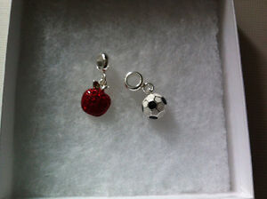 Never taken out of box. Two bracelet or necklace pendents