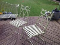 2 foldable sage green steel chairs