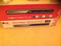 LG DVD player DVX492H with original box and remote
