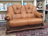 Finely made two seater leather sofa and arm chair