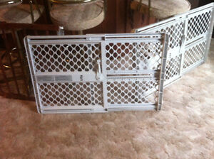 Two plastic adjustable gates  one wood