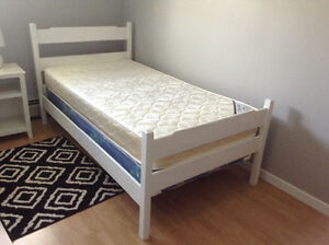 WOOD FRAME TWIN SIZE BED AND TWIN MATTRESS(BoxSpring Sold)