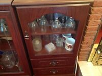 Display glass and wooden cabinet.