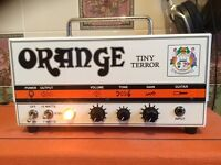 Orange tiny terror and cabinet guitar amp.