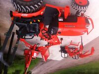Kubota B series 3200 tractor with implements